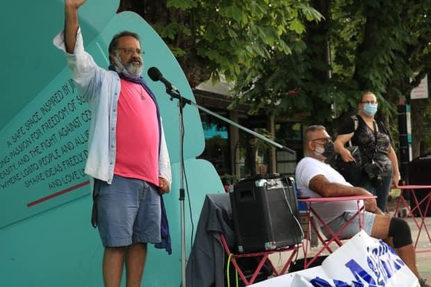 Imtiaz Popat addresses a crowd of protesters last year, alleging Vancouver Police had failed to protect Vancouver's gay community from hate speech.
