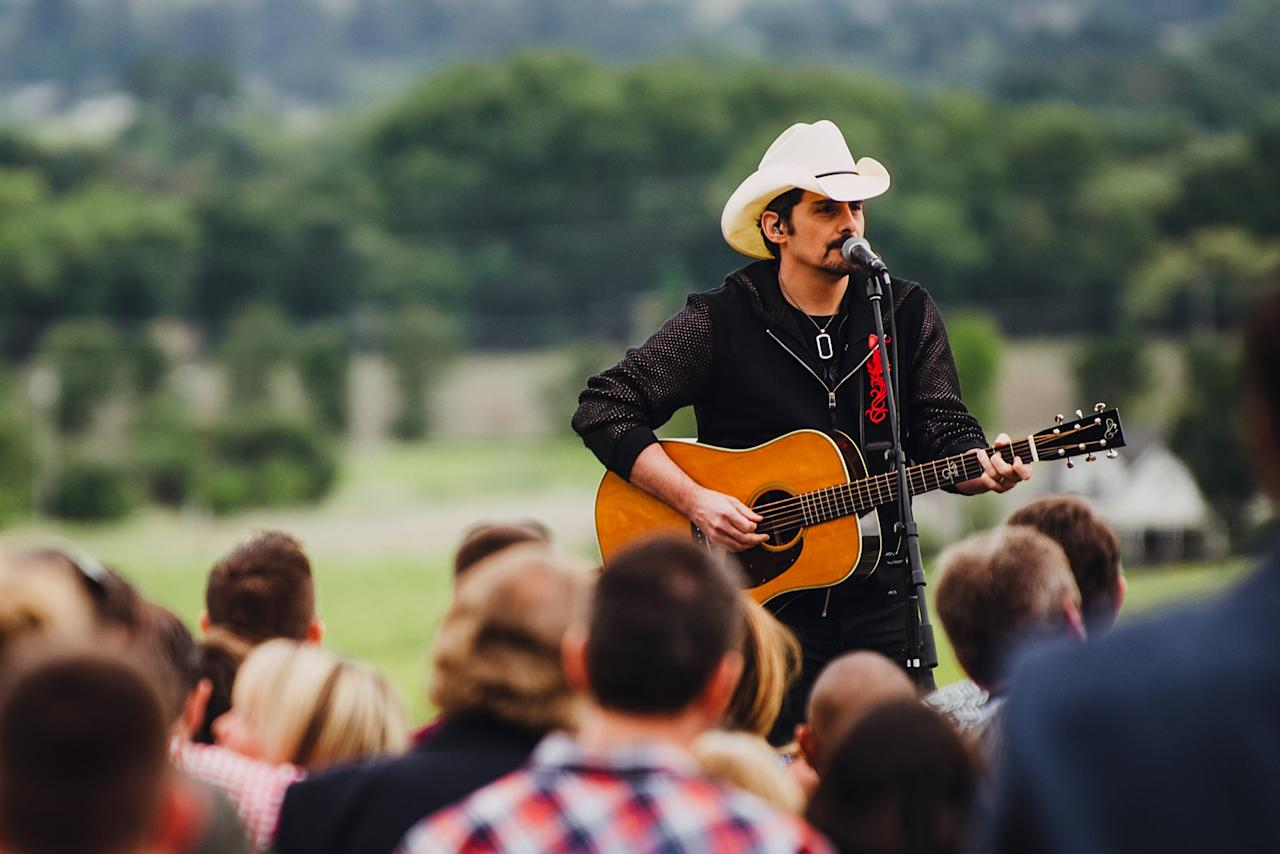 "<a href=""https://people.com/tag/brad-paisley/"">Brad Paisley</a> performs at the weekend's opening reception held at Regusci Winery on May 14."