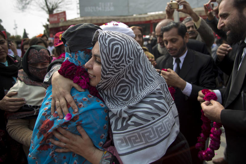 People welcome the family members of missing people during a march in Rawalpindi, Pakistan, Friday, Feb. 28, 2014. Affected families walked nearly 3,000 kilometers to reach capital Islamabad and register protest against the abductions and killings of their loved ones by Pakistani security agencies without producing them in court of law. (AP Photo/B.K. Bangash)