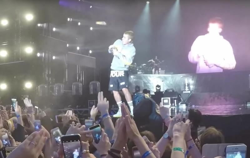 Someone from the crowd hurled an object at Justin. Source: YouTube