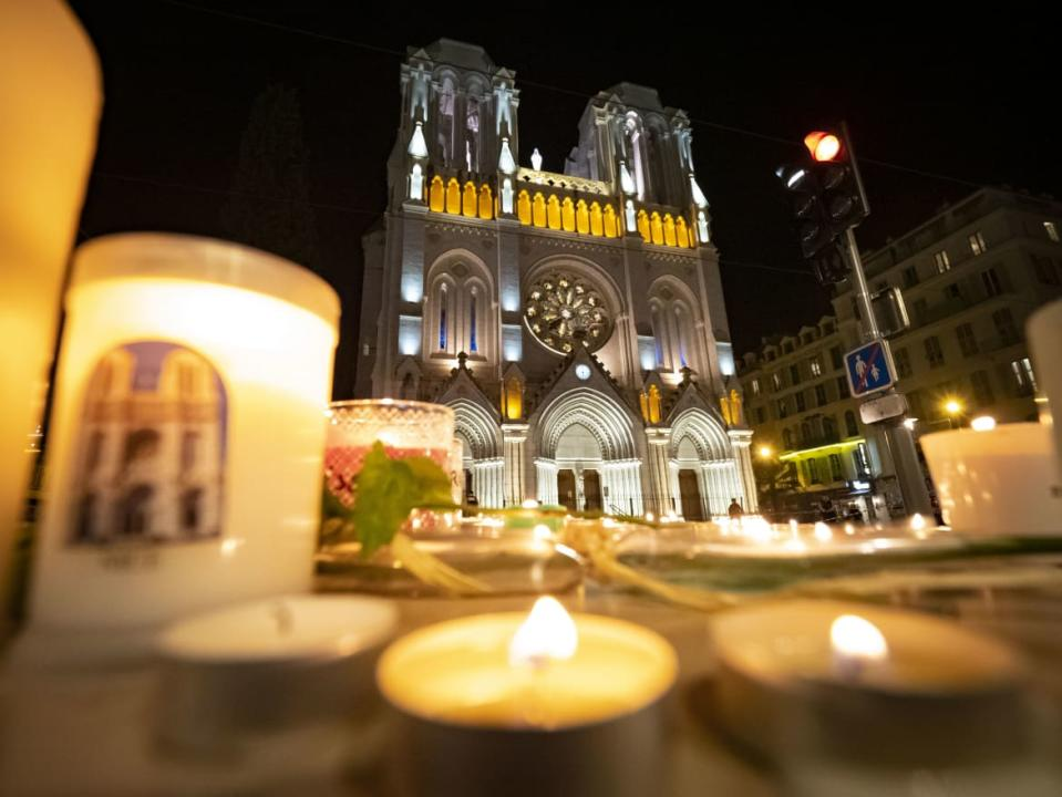 "<div class=""inline-image__caption""><p>People pay tribute at night in front of Notre Dame Basilica on October 29, 2020 in Nice, France</p></div> <div class=""inline-image__credit"">Arnold Jerocki/Getty Images</div>"