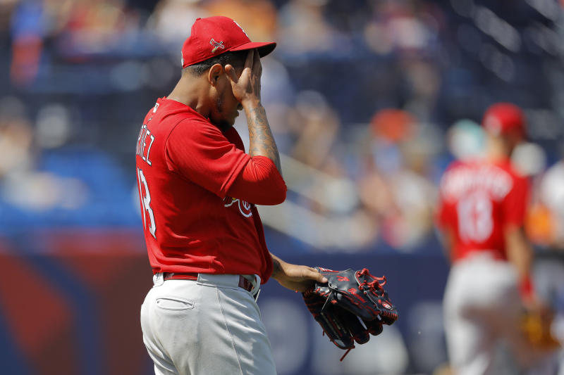 St. Louis Cardinals pitcher Carlos Martinez reacts after giving up a two-run home run to New York Mets' J.D. Davis during the third inning of a spring training baseball game, Wednesday, March 11, 2020, in Port S. Lucie, Fla. (AP Photo/Julio Cortez)