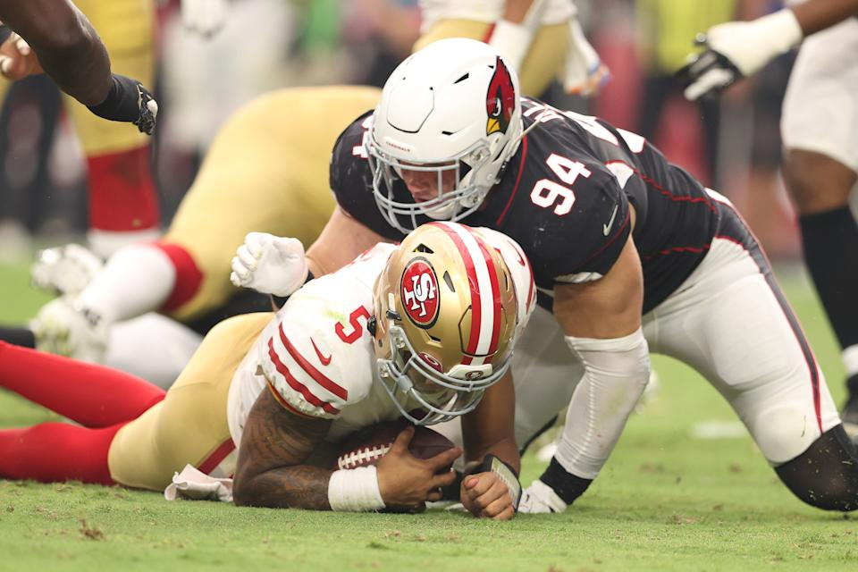 GLENDALE, ARIZONA - OCTOBER 10: Trey Lance #5 of the San Francisco 49ers is sacked by Zach Allen #94 of the Arizona Cardinals at State Farm Stadium on October 10, 2021 in Glendale, Arizona. (Photo by Christian Petersen/Getty Images)