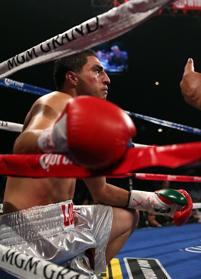 LAS VEGAS, NV - SEPTEMBER 15: Josesito Lopez receives a count from referee Joe Cortez after being knocked down by Canelo Alvarez during their WBC super welterweight title fight at MGM Grand Garden Arena on September 15, 2012 in Las Vegas, Nevada. (Photo by Josh Hedges/Getty Images)