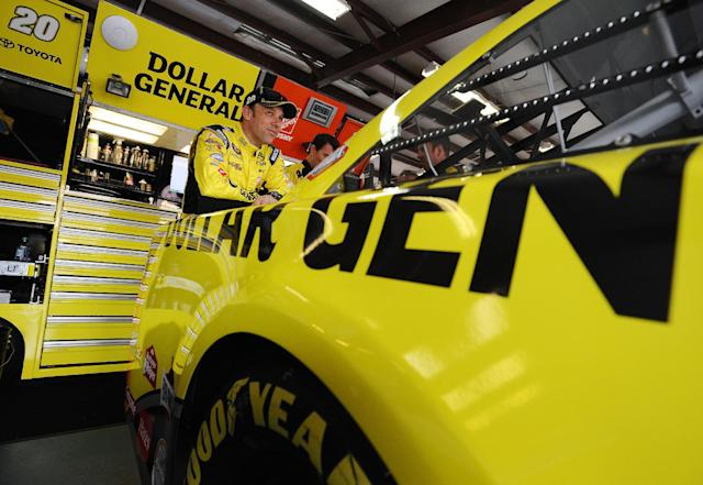 Driver Matt Kenseth stands by his car before practice for Sunday's Aaron's 499 NASCAR auto race at Talladega Superspeedway on Friday, May 2, 2014, in Talladega, Ala. (AP Photo/Rainier Ehrhardt)