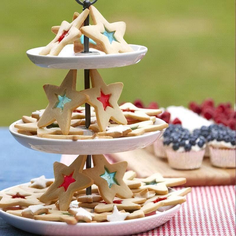 """<p>The hard candy center of these pretty star-shaped cookies is sure to make them stand out at any 4th of July gathering. </p><p><em><strong>Get the recipe for <a href=""""https://www.goodhousekeeping.com/food-recipes/a10139/red-white-blue-star-cookies-recipe-ghk0710/"""" rel=""""nofollow noopener"""" target=""""_blank"""" data-ylk=""""slk:Red, White, and Blue Star Cookies"""" class=""""link rapid-noclick-resp"""">Red, White, and Blue Star Cookies</a>.</strong></em><br></p>"""