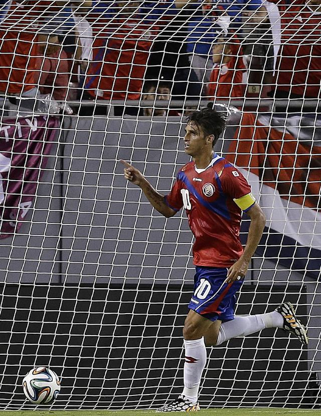 Costa Rica forward Bryan Ruiz celebrates after scoring against Japan during the first half of a friendly soccer match Monday, June 2, 2014, in Tampa, Fla. (AP Photo/Chris O'Meara)