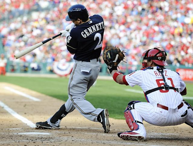 Milwaukee Brewers' Scooter Gennett (2) hits an RBI single to center field in the third inning of a baseball game on Tuesday, April 8, 2014, in Philadelphia. (AP Photo/Michael Perez)