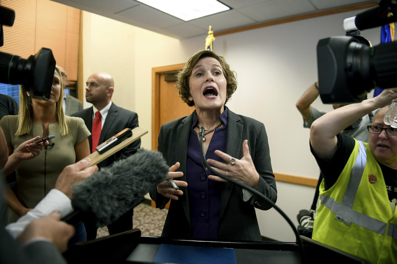 Minneapolis Mayor Betsy Hodges tries to talk to the media as she is shouted at by protesters during her press conference held to discuss the resignation of Minneapolis Police Chief Janee Harteau, at City Hall on Friday, July 21, 2017, in Minneapolis, Minn. Harteau resigned Friday at the request of the mayor, who said she lost confidence in the chief after last weekend's fatal police shooting of an unarmed Australian woman who had called 911. (Aaron Lavinsky/Star Tribune via AP)