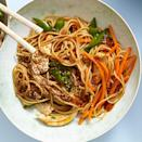 """<p>Classic sesame noodles become a healthy meal with lean chicken and tons of veggies in this quick recipe for Asian noodles. Be sure to rinse the spaghetti until it's cold, then give it a good shake in the colander until it's well drained. Are you a spiralizing pro? Swap 5 cups of raw zucchini, carrot or other veggie """"noodles"""" for the cooked pasta.</p>"""