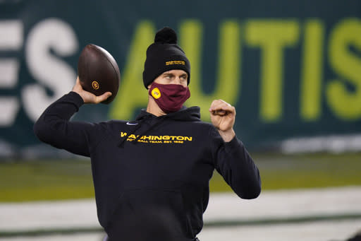 Washington Football Team's Alex Smith warms up before an NFL football game against the Philadelphia Eagles, Sunday, Jan. 3, 2021, in Philadelphia. (AP Photo/Chris Szagola)