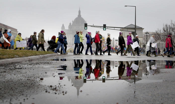 <p>With the Cathedral of Saint Paul to the rear, a steady throng of protestors made their way toward the start of the Women's March Minnesota before their march to the Minnesota State Capitol Saturday, Jan. 21, 2017, in St. Paul, Minn. (David Joles /Star Tribune via AP) </p>