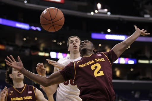 Arizona State's Chris Colvin(2) is fouled by Stanford's Jack Trotter during the first half of an NCAA college basketball game at the Pac-12 Conference tournament in Los Angeles, Wednesday, March 7, 2012. (AP Photo/Jae C. Hong)
