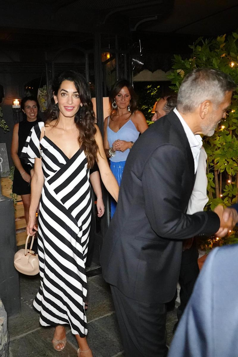 Who: Amal Clooney What: Michelle Mason dress, Gabriela Hearst bag Where: Il Gatto Nero, Cernobbio, Italy When: August 3, 2018