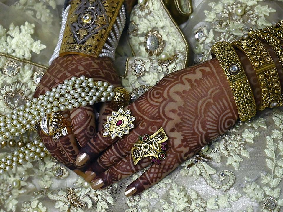 <p>File image: Indian authorities halt wedding of interfaith bride and groom citing the controversial 'love-jihad' law</p> (AFP via Getty Images)