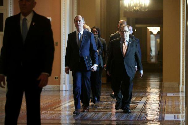 PHOTO: House impeachment managers walk through the Ohio Clock Corridor as they arrive for the procedural start of the Senate impeachment trial of President Donald Trump in the Capitol in Washington, Jan. 16, 2020. (Jonathan Ernst/Reuters)