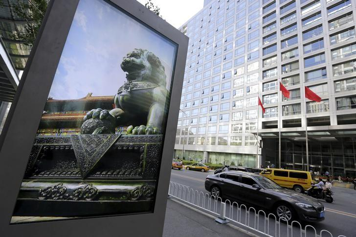 Advertising board showing a Chinese stone lion near an entrance to the headquarters of China Securities Regulatory Commission, in Beijing
