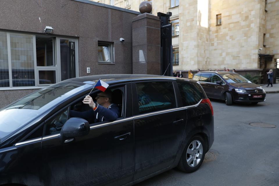 Embassy staff leave the Czech Republic Embassy by a car in Moscow, Russia, Monday, April 19, 2021. Russia has ordered 20 Czech diplomats to leave the country within a day in response to Prague's expulsion of 18 Russian diplomats. The Czech government has alleged the Russian Embassy staffers were spies for a military intelligence agency that was involved in a fatal ammunition depot explosion in 2014. (AP Photo/Pavel Golovkin)