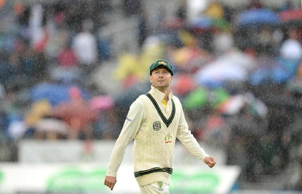 Australia's Michael Clarke looks to the sky as rain stops play, during day five of the Third Investec Ashes test match at Old Trafford Cricket Ground, Manchester.