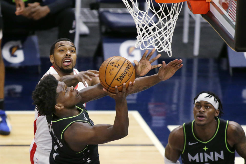 Minnesota Timberwolves forward Anthony Edwards (1) shoots on Houston Rockets forward Sterling Brown during the first quarter of an NBA basketball game Friday, March 26, 2021, in Minneapolis. (AP Photo/Andy Clayton-King)