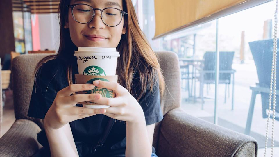 girl drinking Starbucks Coffee