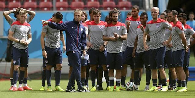 United States' head coach Jurgen Klinsmann, center left, instructs his players during a training session in Recife, Brazil, Wednesday, June 25, 2014. The U.S. will play Germany in group G of the 2014 soccer World Cup on June 26. (AP Photo/Julio Cortez)