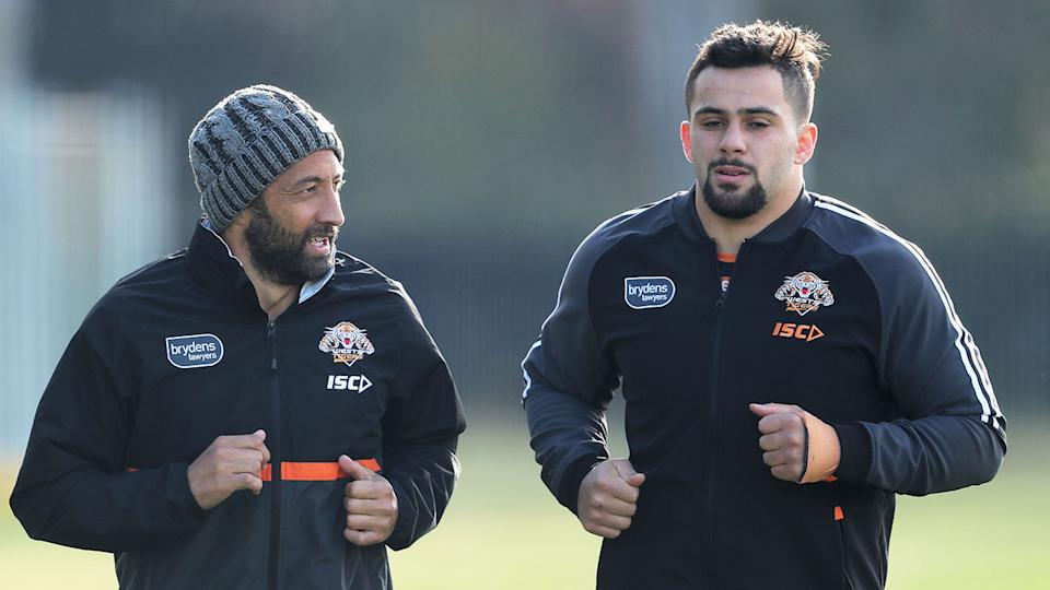Pictured on the right is Josh Aloiai with Wests Tigers teammate Benji Marshall.