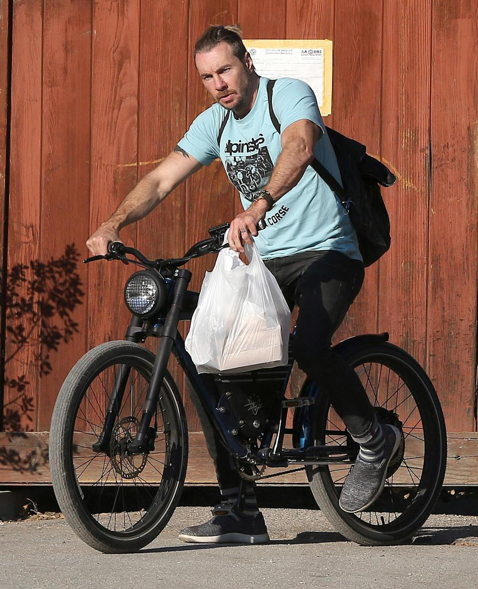 <p>Dax Shepard is seen riding his bike through L.A. after grabbing some food on Wednesday.</p>