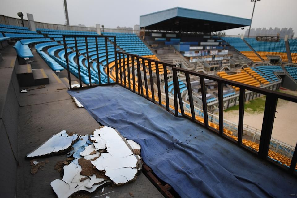 This photo taken on July 23, 2018 shows rotting wood on a stand in the beach volleyball stadium built for the 2008 Beijing Olympic Games, in Beijing. - A decade after Beijing hosted the 2008 Olympics, its legacy remains unmistakable from the smallest alleyways in the Chinese capital to the country's growing clout abroad. For better or worse, the Games changed the face of Beijing: from the iconic Bird's Nest stadium to the countless blocks of ancient homes bulldozed in an Olympic building frenzy. (Photo by GREG BAKER / AFP) / TO GO WITH China-politics-Olympics-anniversary,FOCUS by Ben Dooley        (Photo credit should read GREG BAKER/AFP via Getty Images)