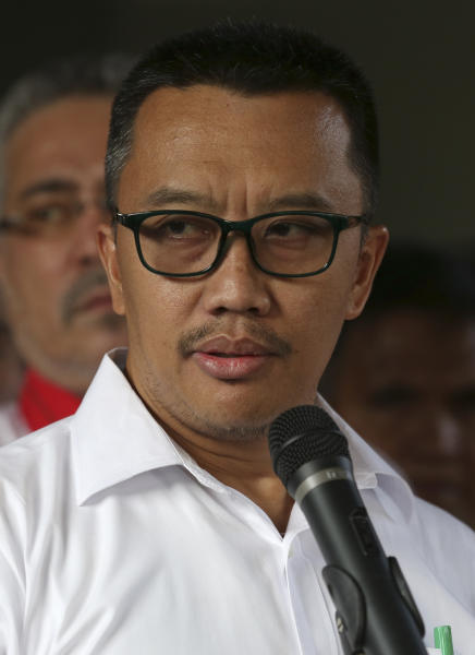 Indonesian Youth and Sports Minister Imam Nahrawi speaks to the media during a press conference in Jakarta, Indonesia, Thursday, Sept. 19, 2019. Nahrawi has stepped down from his position after being named a bribery suspect by the country's anti-graft commission. (AP Photo/Tatan Syuflana)