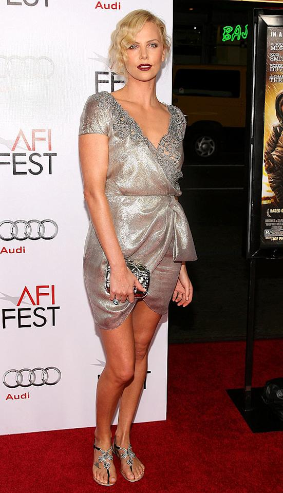 """Charlize Theron is hot; her '20s-inspired ensemble, featuring that finger wave hairdon't, is not. Valerie Macon/<a href=""""http://www.gettyimages.com/"""" target=""""new"""">GettyImages.com</a> - November 4, 2009"""