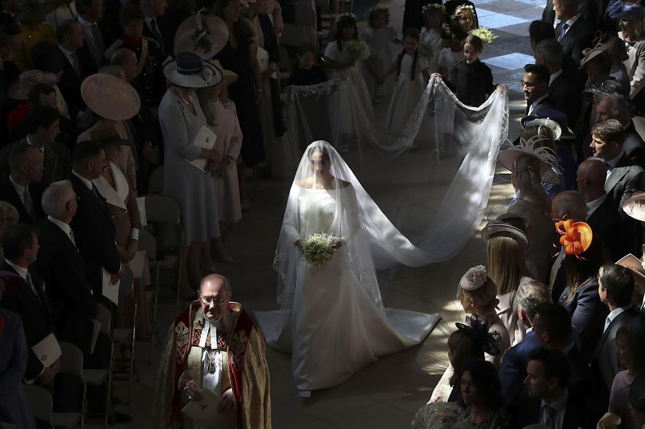 "<p>There were a lot of amazing moments at Prince Harry and Meghan Markle's wedding, but one of the most memorable was when Meghan, modern woman, <a rel=""nofollow"" href=""https://www.marieclaire.com/culture/a20745452/meghan-markle-walked-down-aisle-solo-royal-wedding/"">walked herself down the aisle</a> looking like a literal angel who descended from heaven. Her father-in-law, Prince Charles, joined her closer to the altar, but her grand entrance became an inspiring moment for women everywhere. </p>"