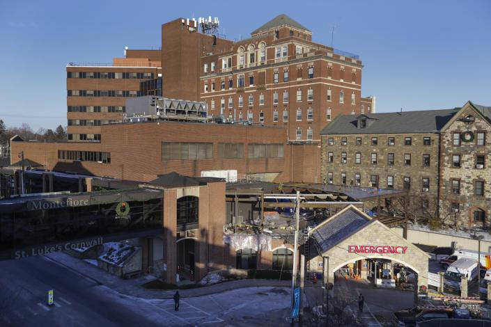 In this Thursday, Dec. 19, 2019 photo, pedestrians pass St. Luke's Cornwall Hospital in Newburgh, N.Y. The hospital adopted the Hudson Valley Interlink Analytic System earlier this year, which tracks drug overdoses in New York. The system is among a number of surveillance systems being adopted around the country by police, government agencies and community groups.(AP Photo/Frank Franklin II)