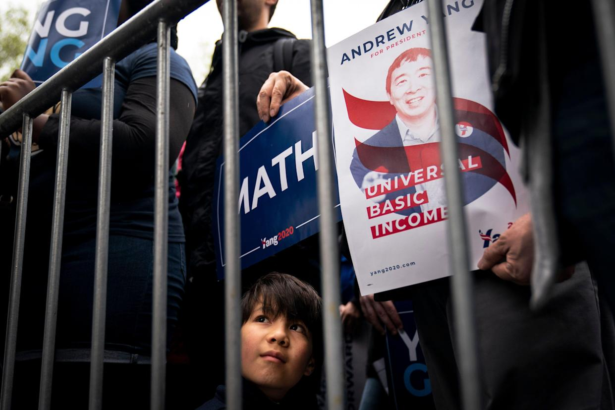 Isaac Tom, 10, listens attentively to Yang's speech. (Photo: Drew Angerer/Getty Images)
