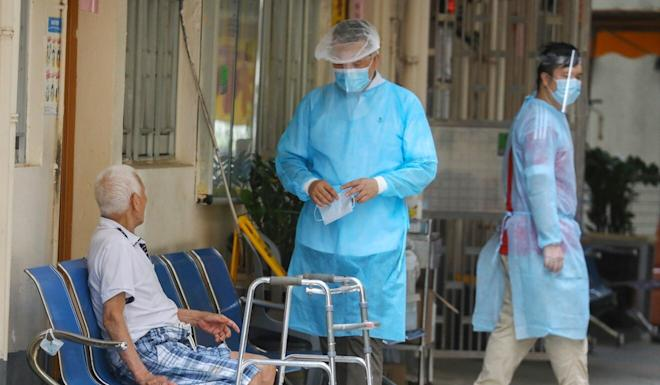 Medical workers take care of a man at Cornwall Elderly's Home Golden Branch in Tuen Mun in July. Photo: Dickson Lee