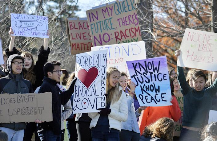 <p>Demonstrators hold signs during a protest against the election of Donald Trump on Saturday, Nov. 12, 2016 in WIlliamstown, Mass. (Ben Garver/The Berkshire Eagle via AP) </p>