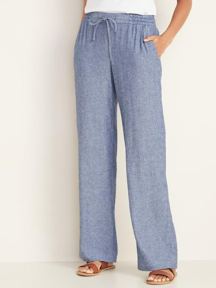 """<p>Style these blue <a href=""""https://www.popsugar.com/buy/Old-Navy-Mid-Rise-Wide-Leg-Linen-Blend-Pull--Pants-551921?p_name=Old%20Navy%20Mid-Rise%20Wide-Leg%20Linen-Blend%20Pull-On%20Pants&retailer=oldnavy.gap.com&pid=551921&price=35&evar1=fab%3Aus&evar9=47254489&evar98=https%3A%2F%2Fwww.popsugar.com%2Ffashion%2Fphoto-gallery%2F47254489%2Fimage%2F47256321%2FOld-Navy-Mid-Rise-Wide-Leg-Linen-Blend-Pull-On-Pants-in-Chambray-Blue&list1=old%20navy%2Cpants%2Ctravel%20style%2Cspring%20fashion%2Cfashion%20shopping&prop13=mobile&pdata=1"""" rel=""""nofollow"""" data-shoppable-link=""""1"""" target=""""_blank"""" class=""""ga-track"""" data-ga-category=""""Related"""" data-ga-label=""""https://oldnavy.gap.com/browse/product.do?pid=551156052&amp;cid=1061987&amp;pcid=5475&amp;vid=1&amp;grid=pds_135_314_1#pdp-page-content"""" data-ga-action=""""In-Line Links"""">Old Navy Mid-Rise Wide-Leg Linen-Blend Pull-On Pants</a> ($35, originally $40) with sandals and a tee.</p>"""