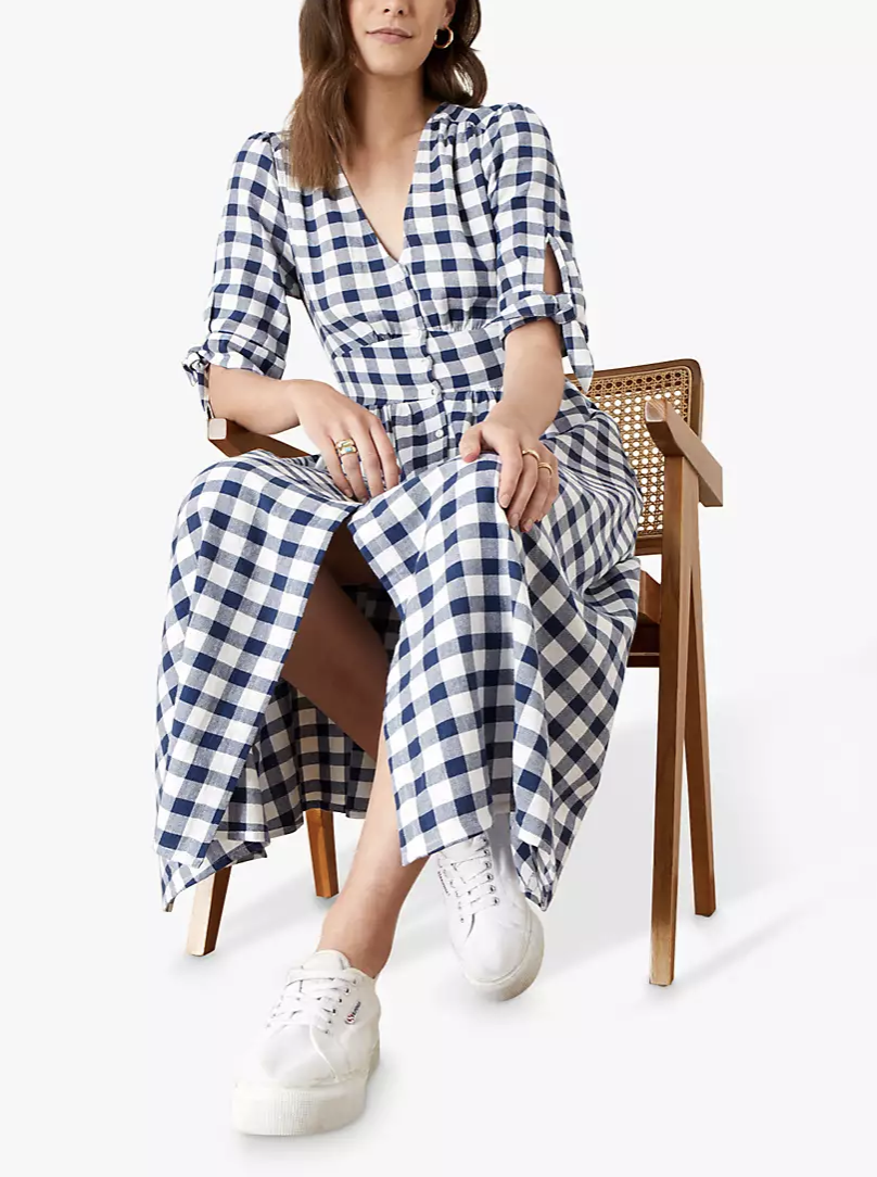 This Monsoon midi dress is the perfect summer wardrobe staple, as it can be dressed up or down with trainers.  (John Lewis & Partners)