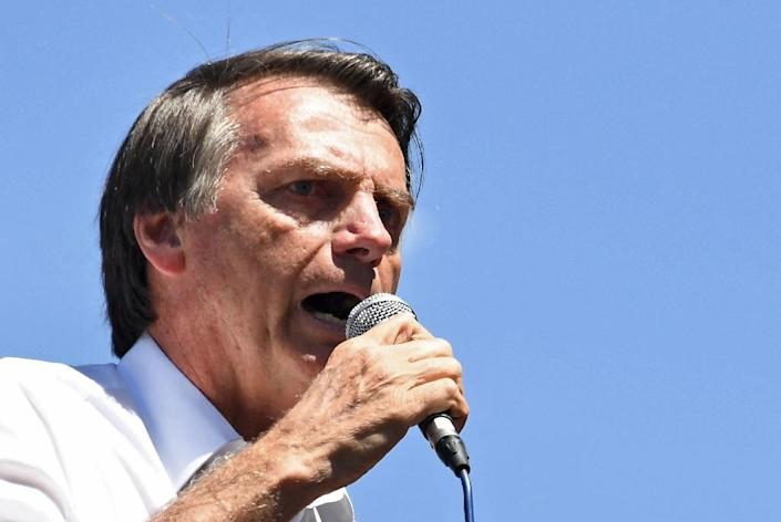 Bolsonaro has been off the campaign trail since he was stabbed at a rally in early September, suffering serious wounds (AFP Photo/EVARISTO SA)