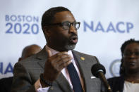 FILE - In this Thursday, Dec. 12, 2019, file photo, National Association for the Advancement of Colored People President Derrick Johnson faces reporters during a news conference in Boston. Facebook CEO Mark Zuckerberg and Chief Operating Officer Sheryl Sandberg met with civil rights leaders, Tuesday, July 7, 2020, including the organizers of a widespread advertising boycott of the social network over hate speech on its platform. Johnson, who was present on the Zoom meeting, said Facebook's executives only delivered cheap talk, filled with little commitment to new rules or actions that would curb racism and misinformation. (AP Photo/Steven Senne, File)