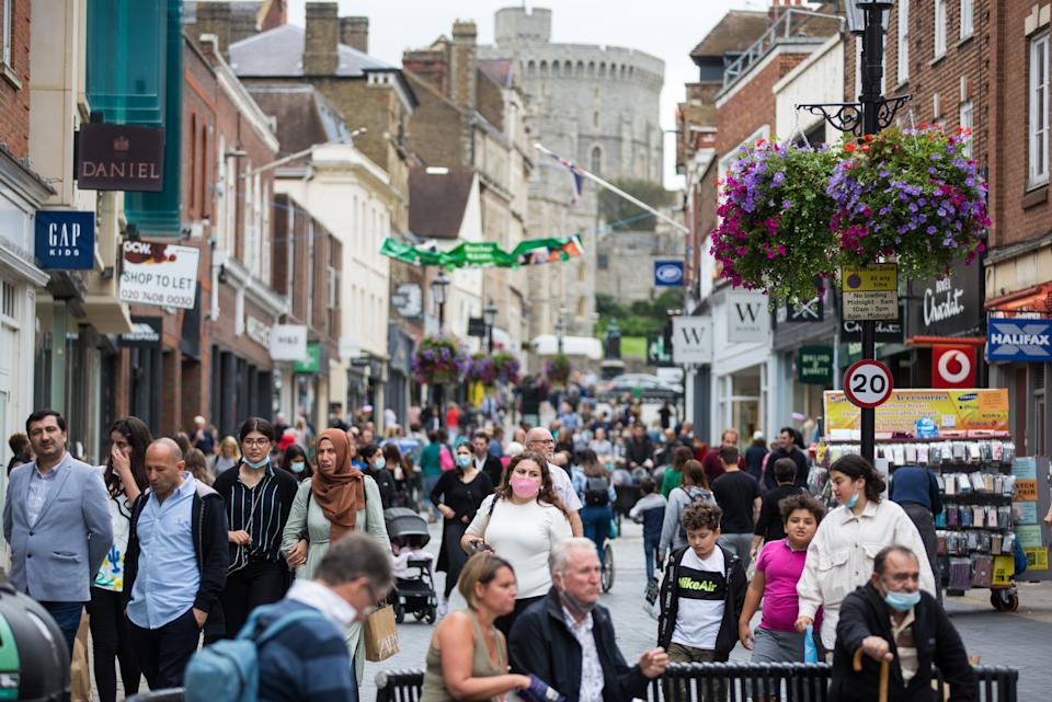 Some shoppers in Windsor wear face coverings, but many don't, despite the director of public health for Berkshire urging residents to follow social distancing guidelines following a significant rise in the number of positive COVID-19 tests in the past week. (Mark Kerrison/In Pictures via Getty Images)