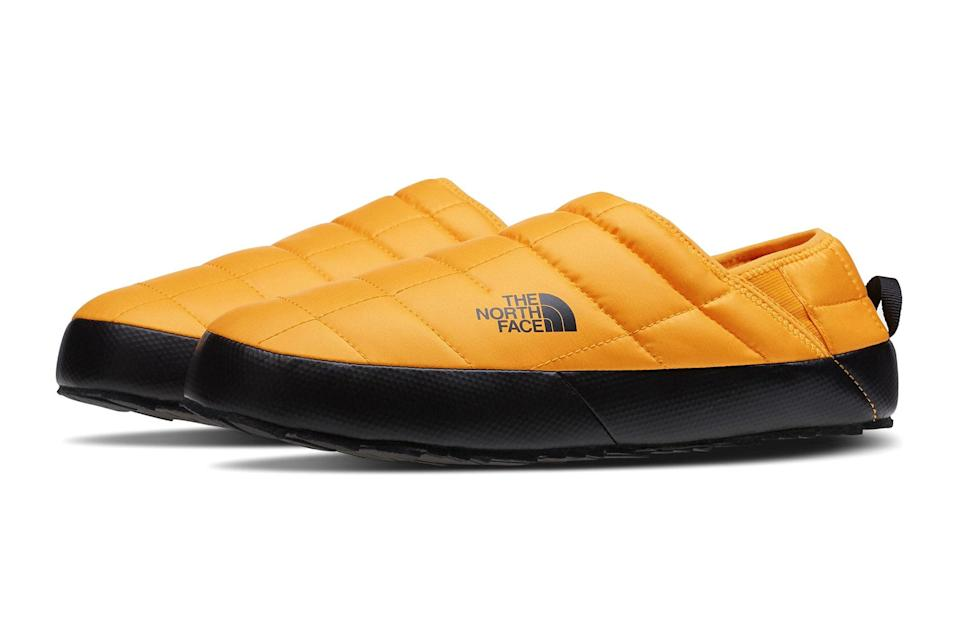 """We all learned to embrace the house shoe in 2020. In 2021, that love affair will only grow deeper.<br> <br> <em>The North Face ThermoBall traction water resistant slipper</em> $55, Nordstrom. <a href=""""https://www.nordstrom.com/s/the-north-face-thermoball-traction-water-resistant-slipper-men/5723601?origin=category-personalizedsort&breadcrumb=Home%2FMen%2FShoes%2FSlippers&color=summit%20gold%2F%20black"""" rel=""""nofollow noopener"""" target=""""_blank"""" data-ylk=""""slk:Get it now!"""" class=""""link rapid-noclick-resp"""">Get it now!</a>"""