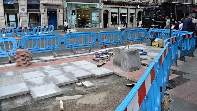 London roadworks with a blue safety barrier