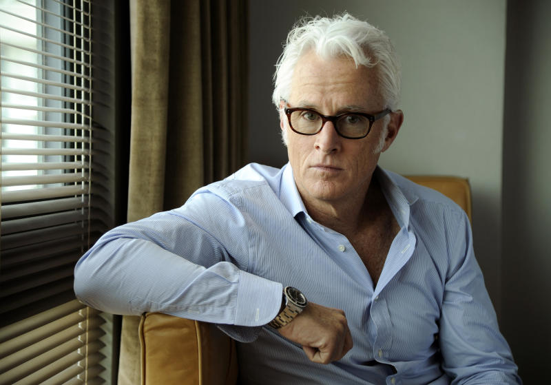 """In this Thursday, May 1, 2014 photo, actor/director John Slattery poses for a portrait on Thursday, May 1, 2014 in Los Angeles. The """"Mad Men"""" actor Slattery makes his directorial debut with """"God's Pocket,"""" a independent film based on Peter Dexter's novel about overlapping working class lives. It's also one of the final performances by the late Philip Seymour Hoffman. (Photo by Chris Pizzello/Invision/AP)"""