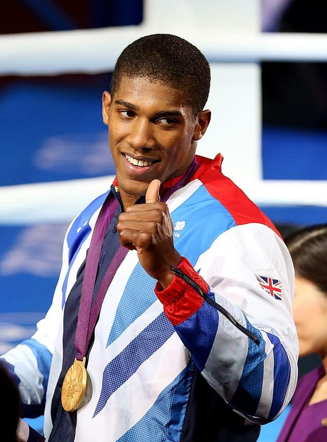 Anthony Joshua with his Olympic gold medal from London 2012 (Julien Behal/PA).