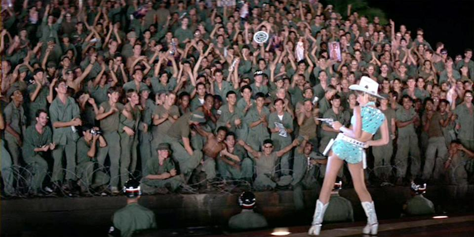 "LOS ANGELES - AUGUST 15: The movie ""Apocalypse Now"", directed by Francis Ford Coppola. Seen here in foreground, facing troops, Cynthia Wood as Carrie Foster, Playmate of the Year. Initial theatrical release August 15, 1979. Screen capture. Paramount Pictures. (Photo by CBS via Getty Images)"