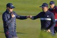 Team USA's Justin Thomas is congratulated by Team USA assistant captain Zack Johnson during a foursomes match the Ryder Cup at the Whistling Straits Golf Course Saturday, Sept. 25, 2021, in Sheboygan, Wis. (AP Photo/Jeff Roberson)