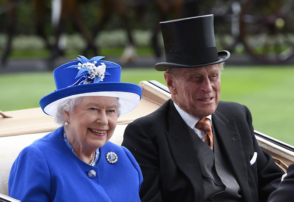 ASCOT, ENGLAND - JUNE 17:  Queen Elizabeth ll and Prince Philip, Duke of Edinburgh arrive in an open carriage to attend day 2 of Royal Ascot on June 17, 2015 in Ascot, England. (Photo by Anwar Hussein/WireImage)