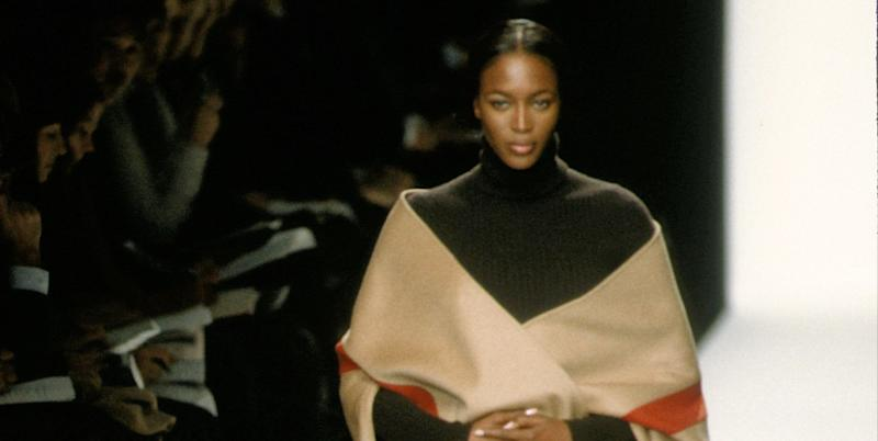 Michael Kors is re-releasing an iconic cape worn by Joan Didion and Naomi Campbell