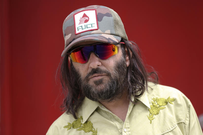 """Los Angeles artist Erik Brunetti, the founder of the streetwear clothing company """"FUCT,"""" poses for a photo in Los Angeles Thursday, April, 11, 2019. """"We wanted the viewer to question it: Like, is that pronounced the way I think it's pronounced?"""" he said of his streetwear brand """"FUCT,"""" which began selling clothing in 1991. On April 15, the Supreme Court will hear Brunetti's challenge to a part of federal law that says officials should refuse to register trademarks that are """"scandalous"""" or """"immoral."""" (AP Photo/Damian Dovarganes)"""